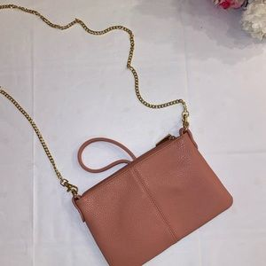 Pink cross body purse with metal chain. Never used